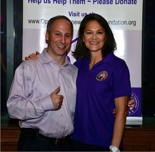 "Hypnotist Marc Hausman and ORHF Executive Director Kim Young at the ""Hypnotic Experience"" sponsored by Operation Renewed Hope Foundation"